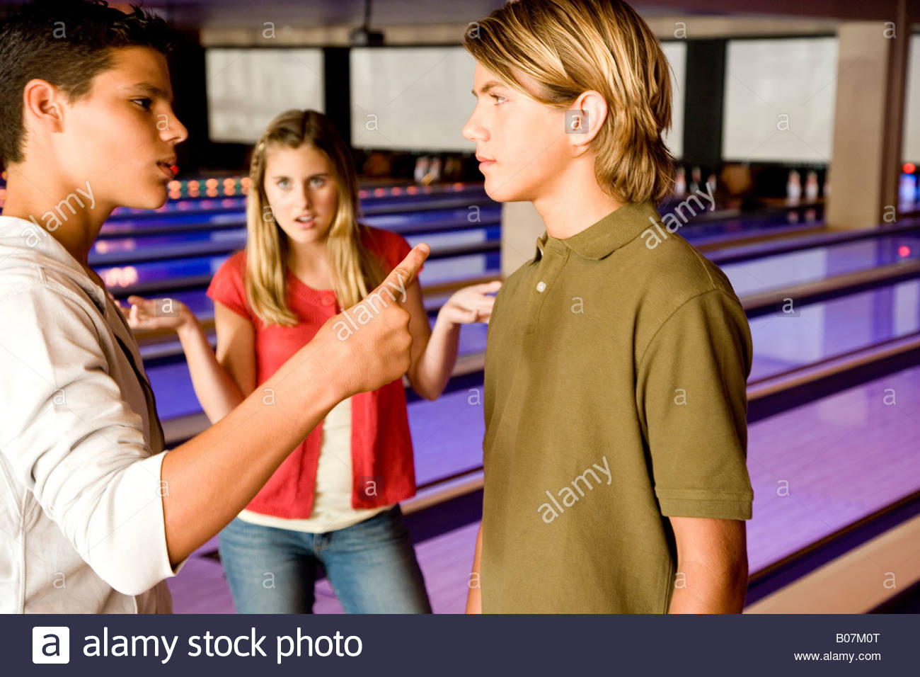 Argument between teenage boys in a bowling alley - Stock Image