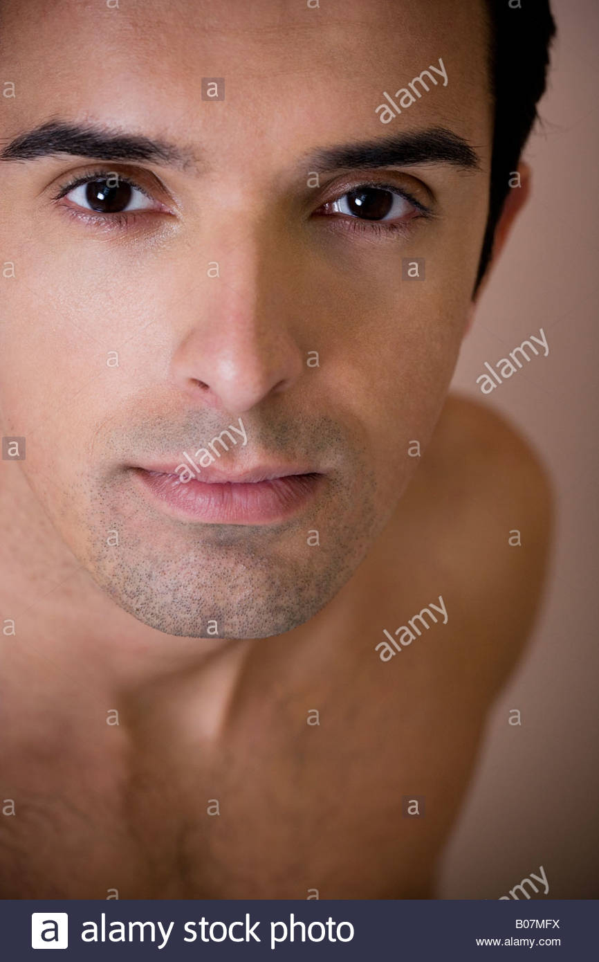 Portrait of a young man looking to camera - Stock Image
