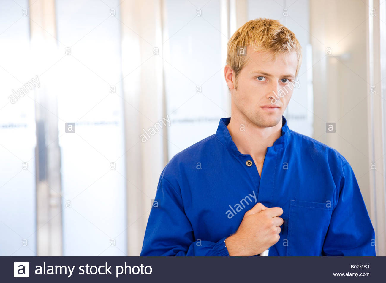 Office cleaner or janitor, half length portrait - Stock Image