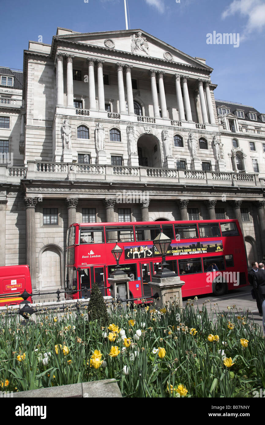 Red double decker bus, Bank of England, Threadneedle Street, City of London, England - Stock Image