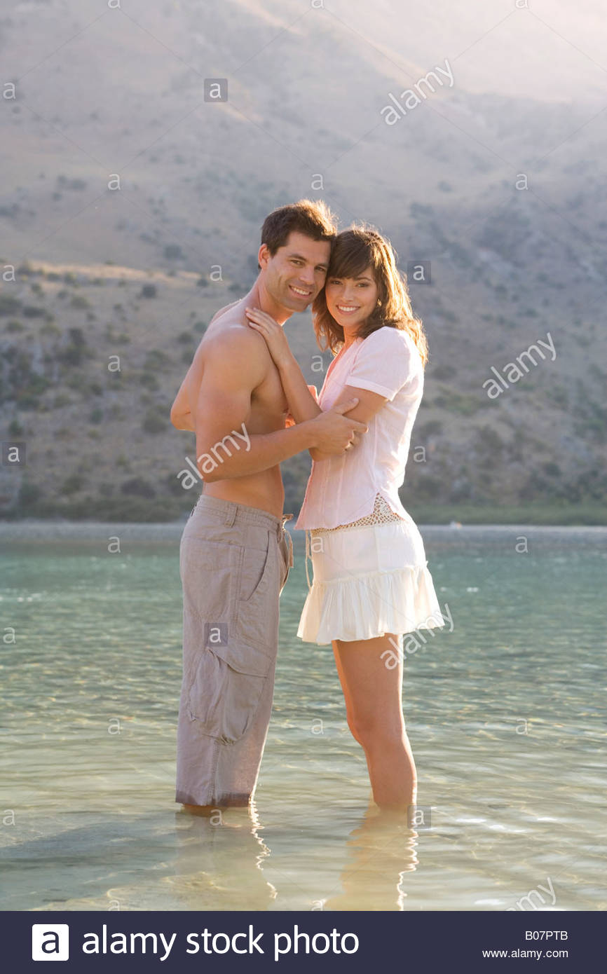 A couple paddling in a lake - Stock Image
