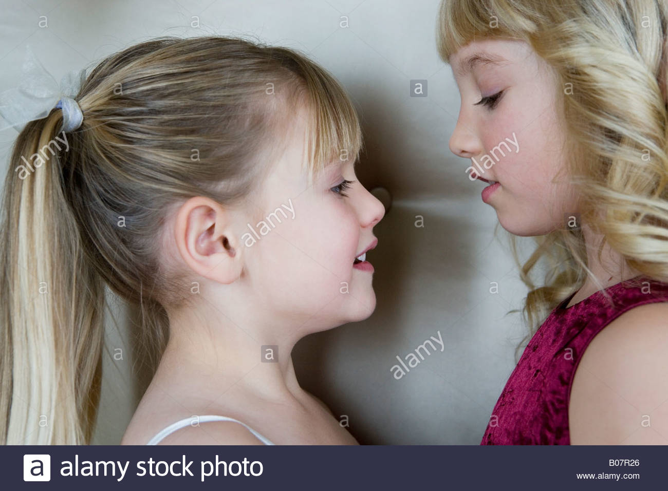 Two friends in party dresses - Stock Image