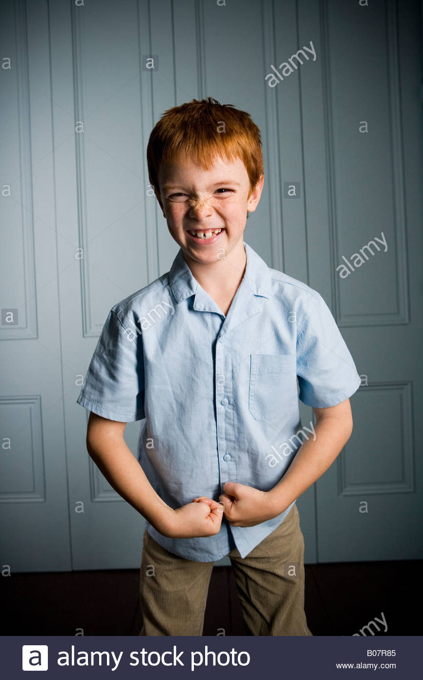 boy with ginger hair making  a face - Stock Image
