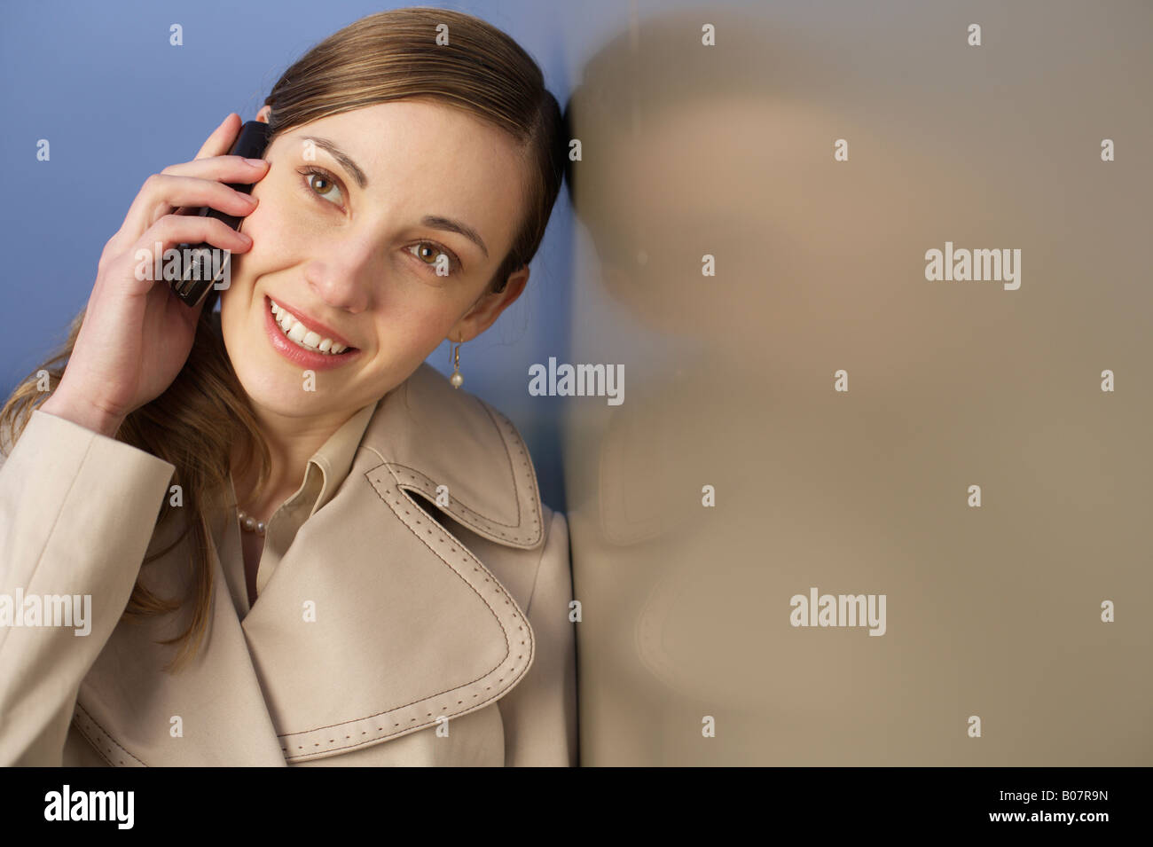 Businesswoman phoning with a mobile phone - Stock Image