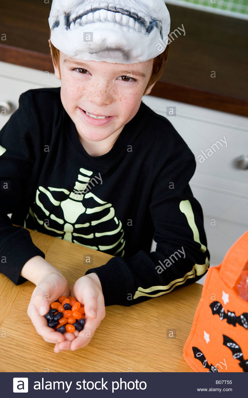 Little boy with trick or treat sweets - Stock Image