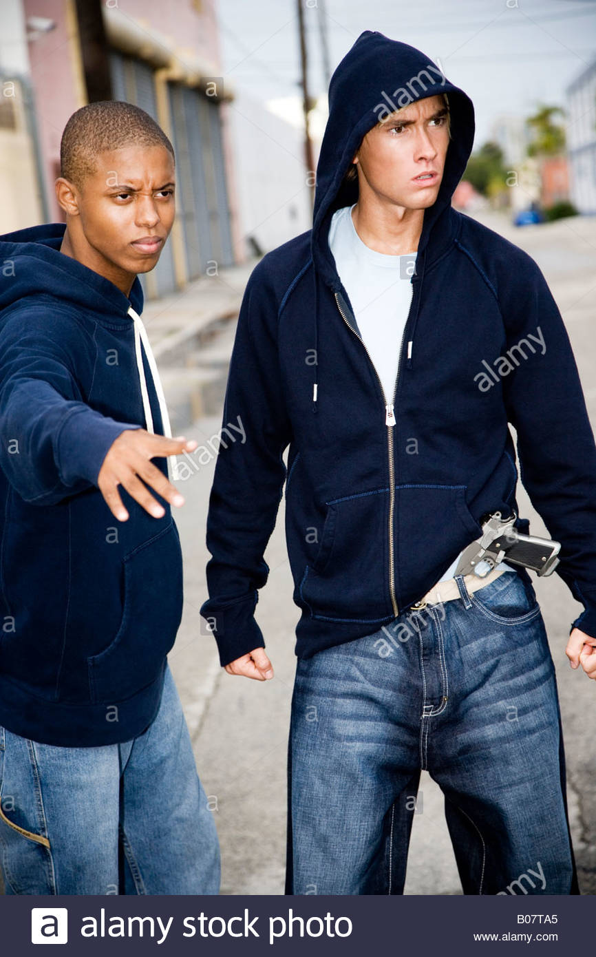 Portrait of two young street gang members Stock Photo