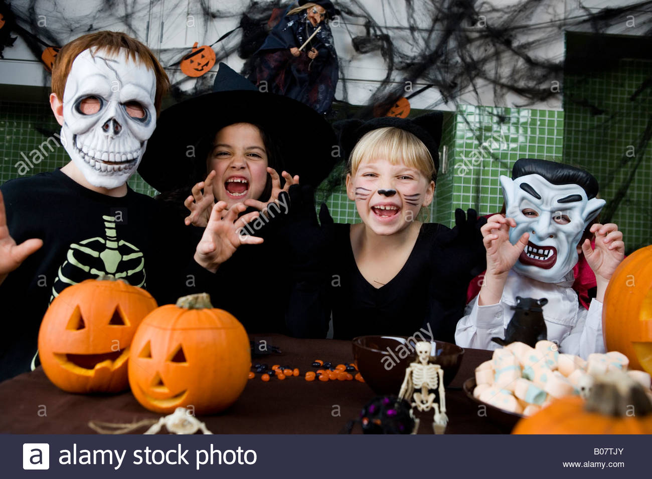 Four friends at a Halloween party - Stock Image