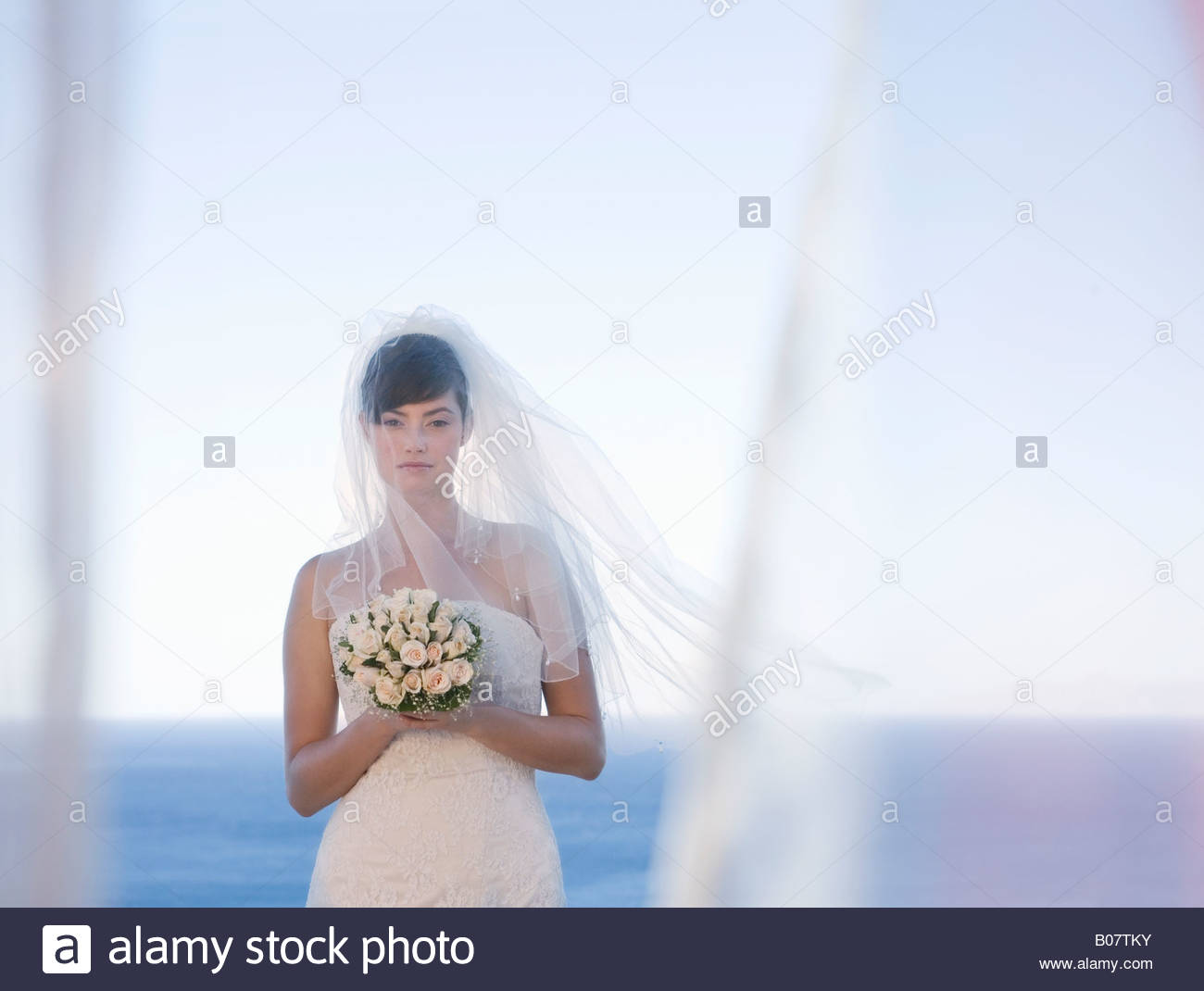 A bride holding her bouquet - Stock Image