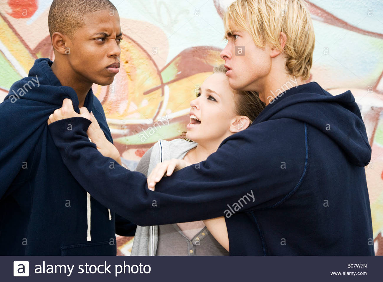 Two guys fighting over a girl
