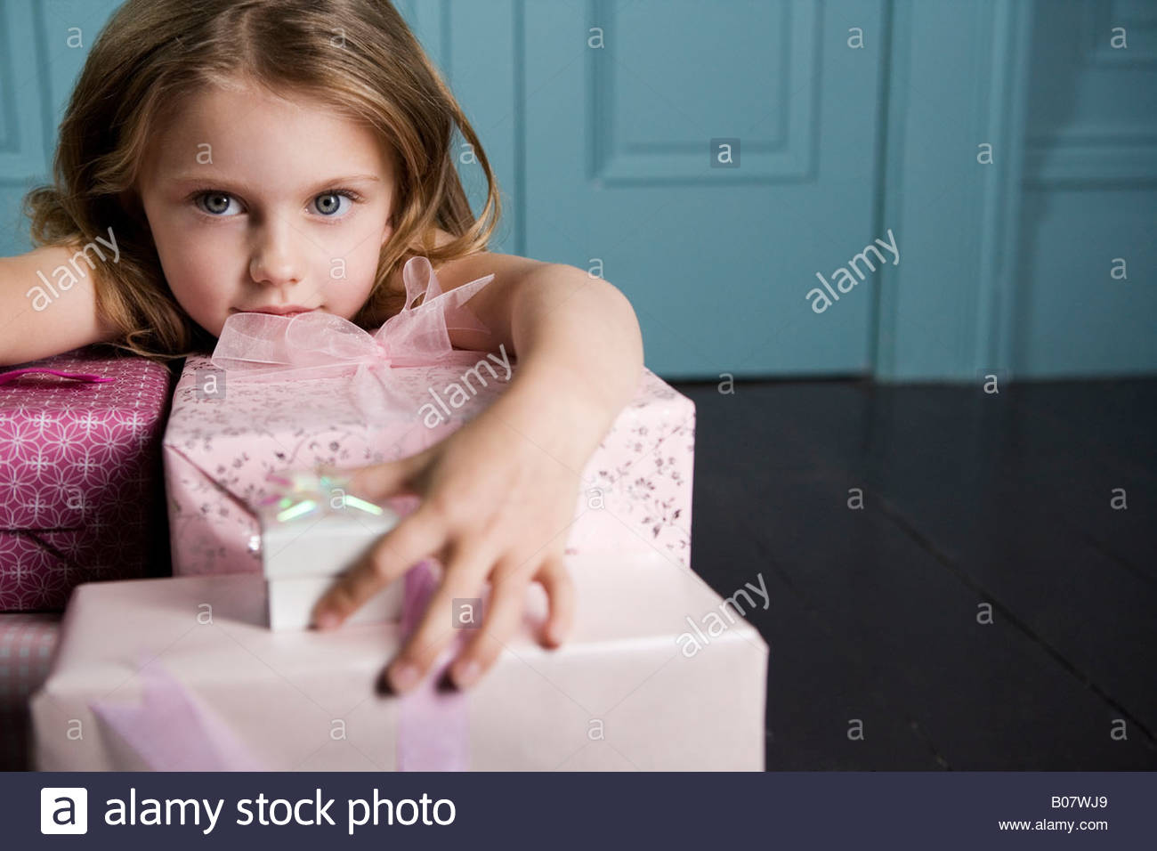 Young girl with birthday presents - Stock Image