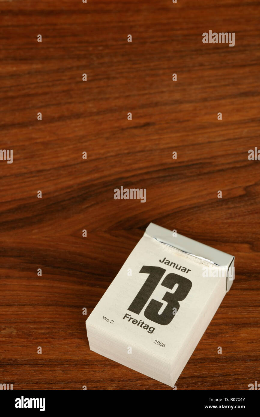 Friday 13 January on a tearing off calendar - Stock Image