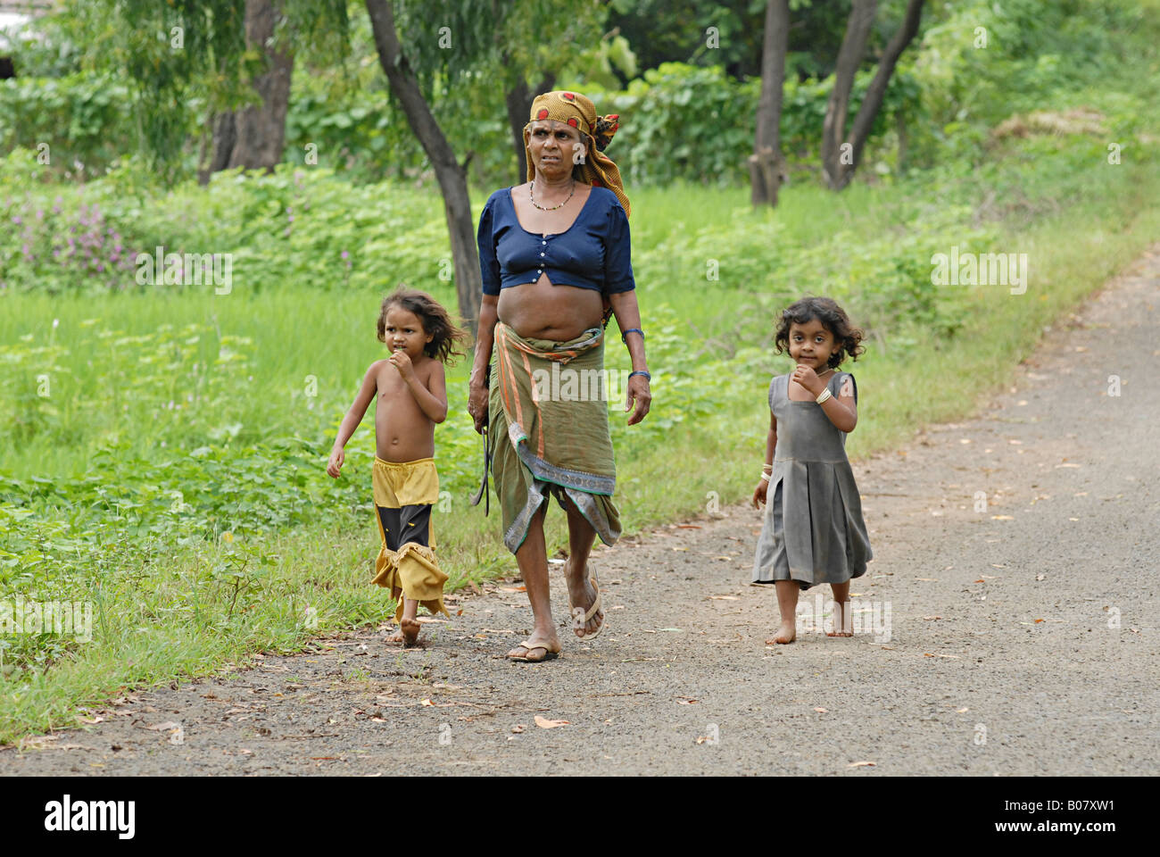 Mother along with her kids warli tribe thane maharashtra india warli tribe thane maharashtra india altavistaventures Image collections