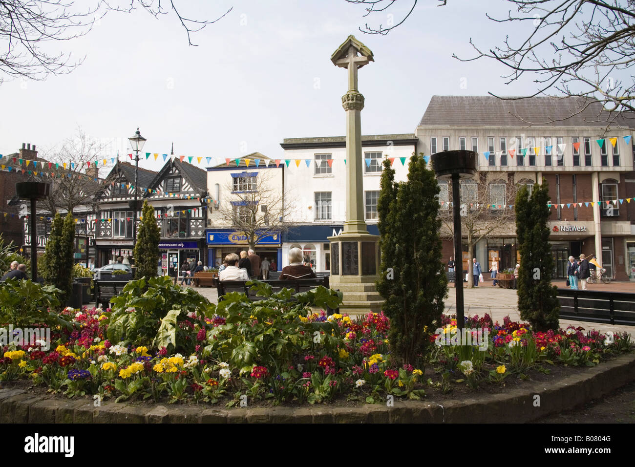 NANTWICH CHESHIRE April The War Memorial in the pedestrianised centre of this historic town with many black and - Stock Image