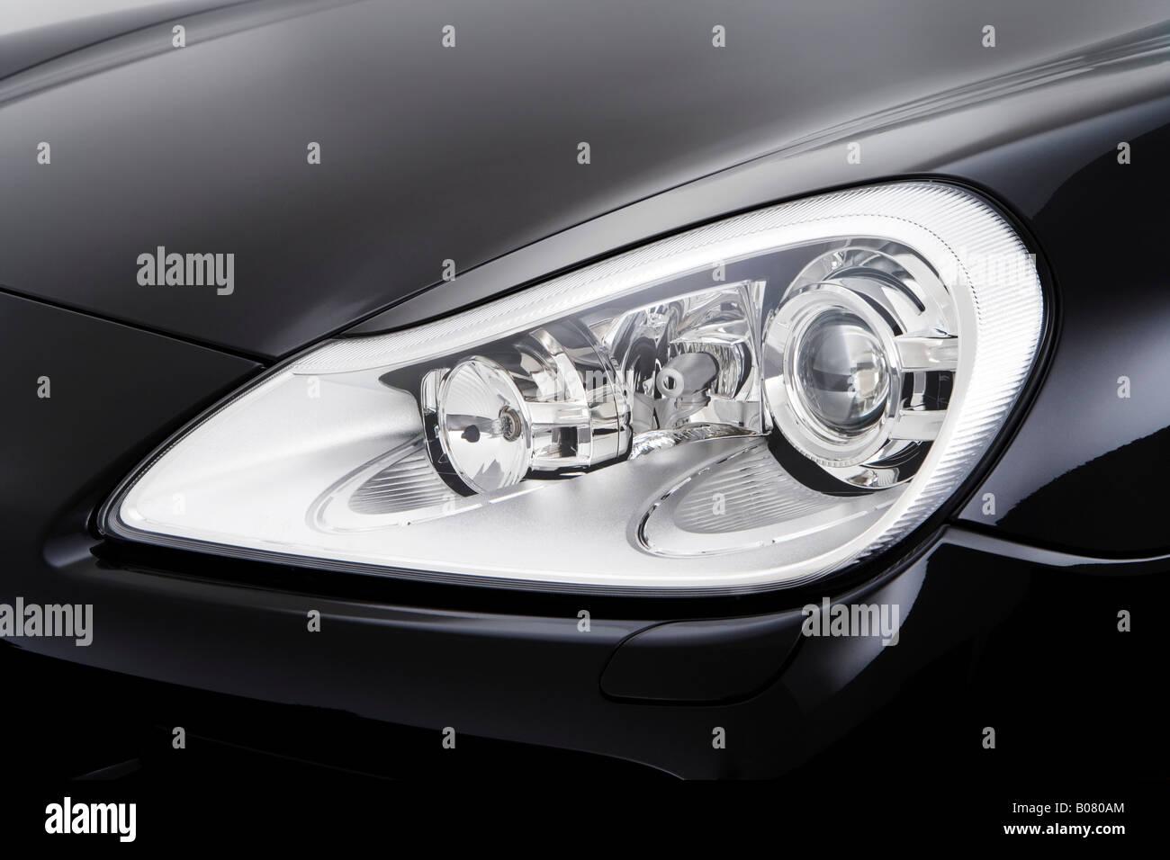 2008 Porsche Cayenne S In Black Headlight Stock Photo