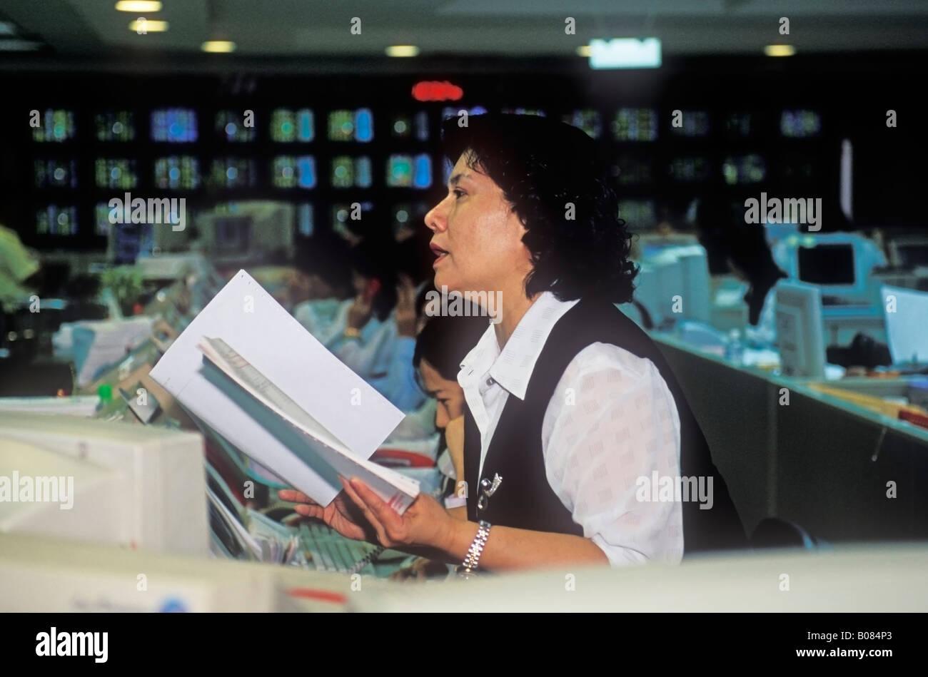 Woman Calling Out A Trade At Stock Trading Desk Taiwan China