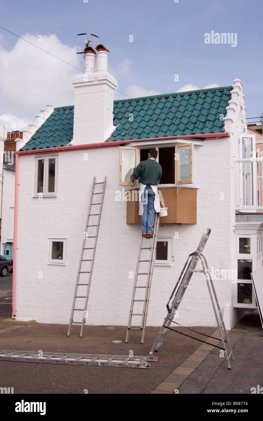 Astonishing Man Painting Exterior Window On House Up Ladder In The Uk Download Free Architecture Designs Ferenbritishbridgeorg