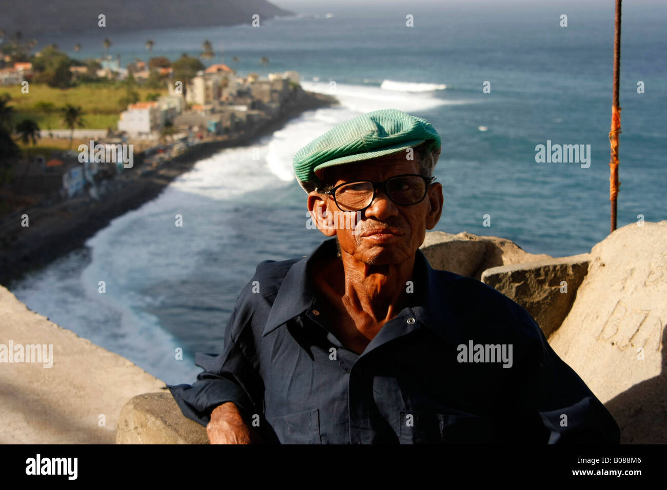 elderly man with glasses in the small village of Vila das Pombas on the coast of Santo Antao Cape Verde - Stock Image