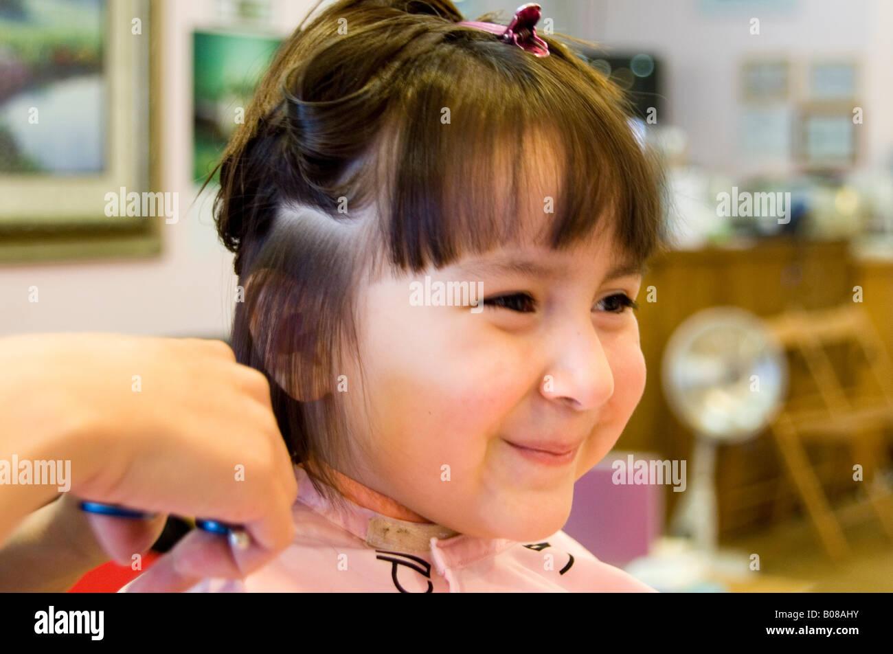 Little Girl Getting Her Hair Cut Stock Photo 17394327 Alamy