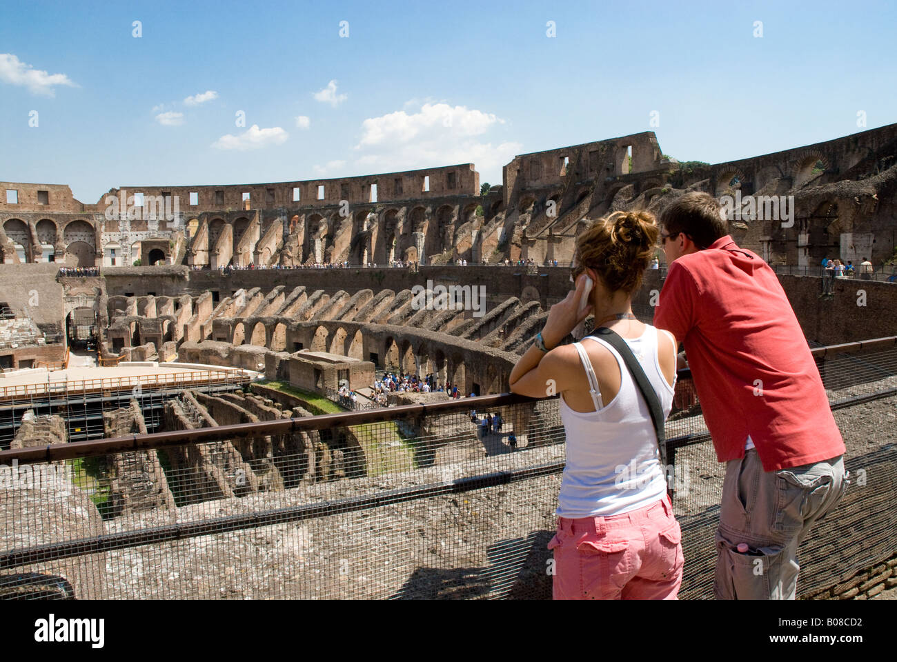 Colosseum  Colosseo, Rome Two tourists in T shirts looking over the Arena and hypogeum - Stock Image
