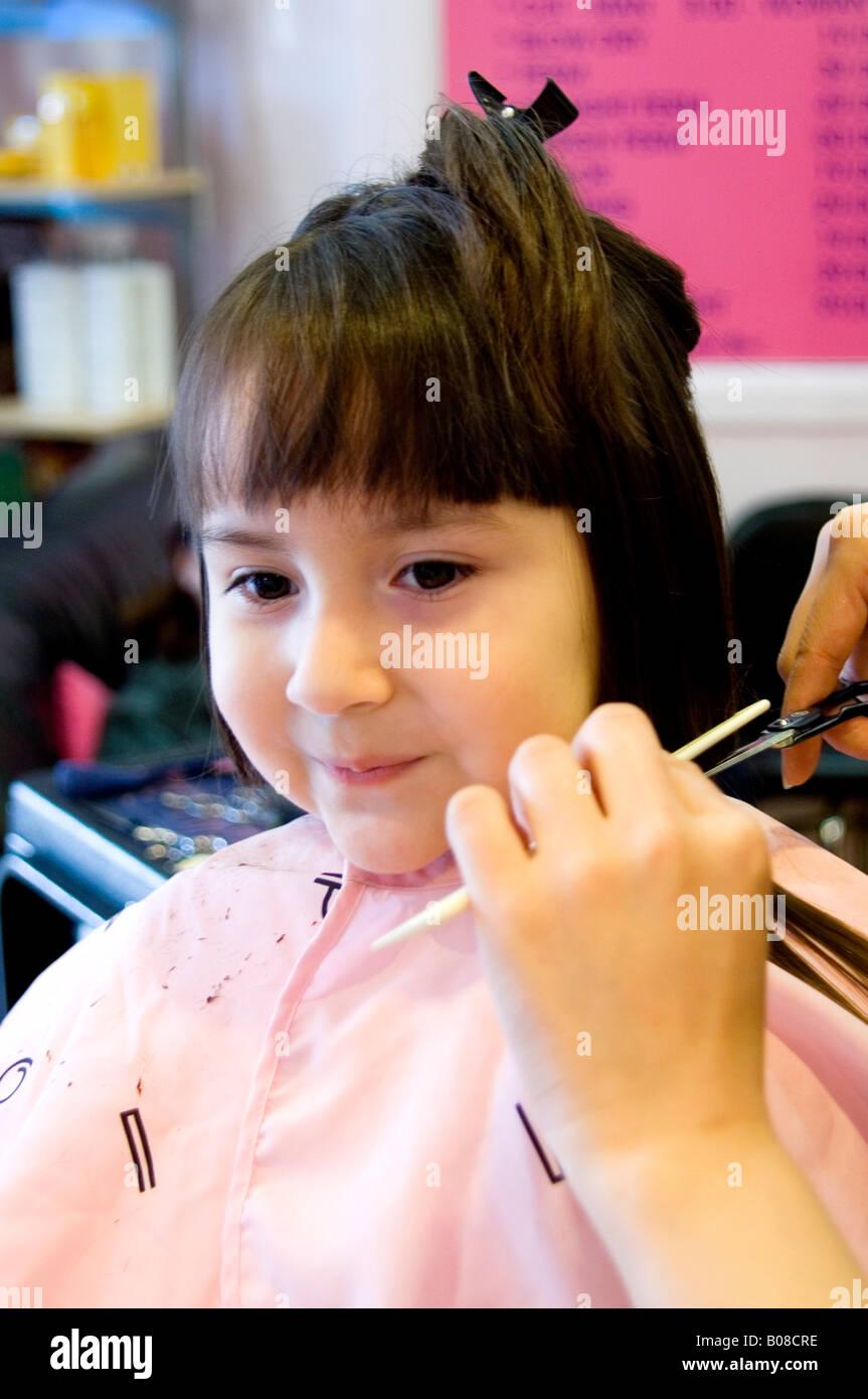 Little Girl Getting Her Hair Cut Stock Photo 17396050 Alamy