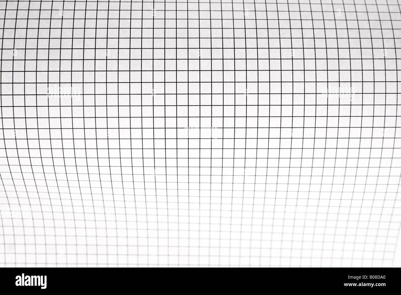 A Sheet Of Graph Paper Curving Out Focus