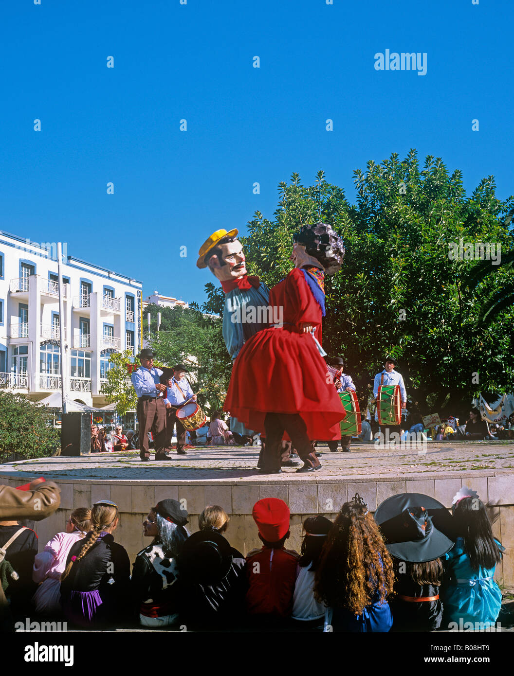 Costumed figures dancing in the central plaza of Albufeira early Febuary at the start of Lent Algarve Purtugal - Stock Image