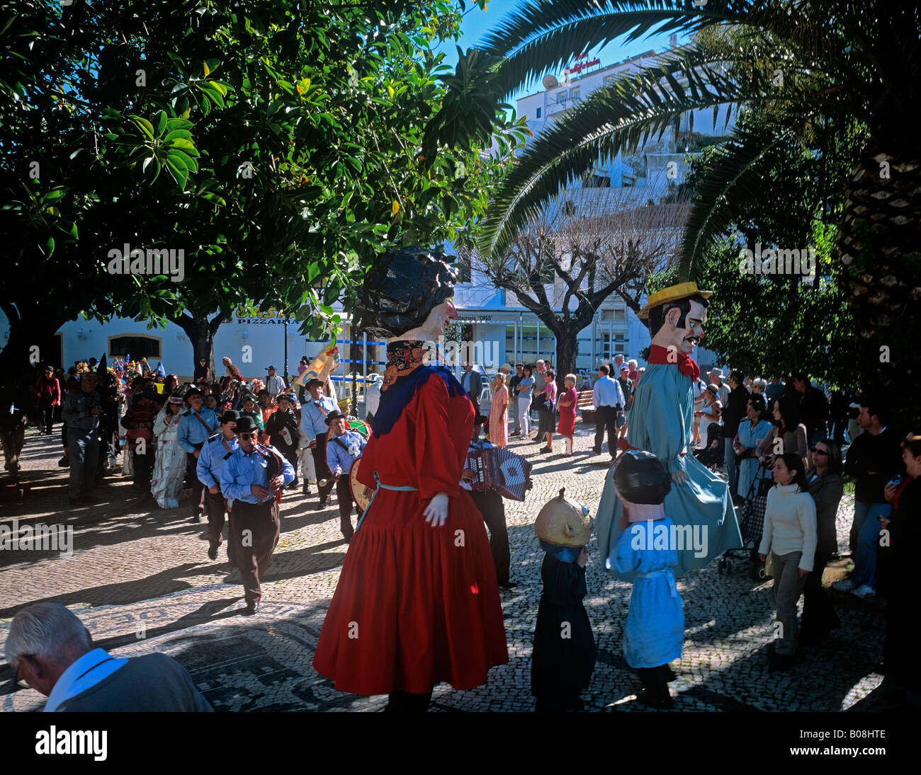 Costumed figures dancing in the central plaza of Albufeira early Febuary at the start of Lent season Algarve Purtugal - Stock Image