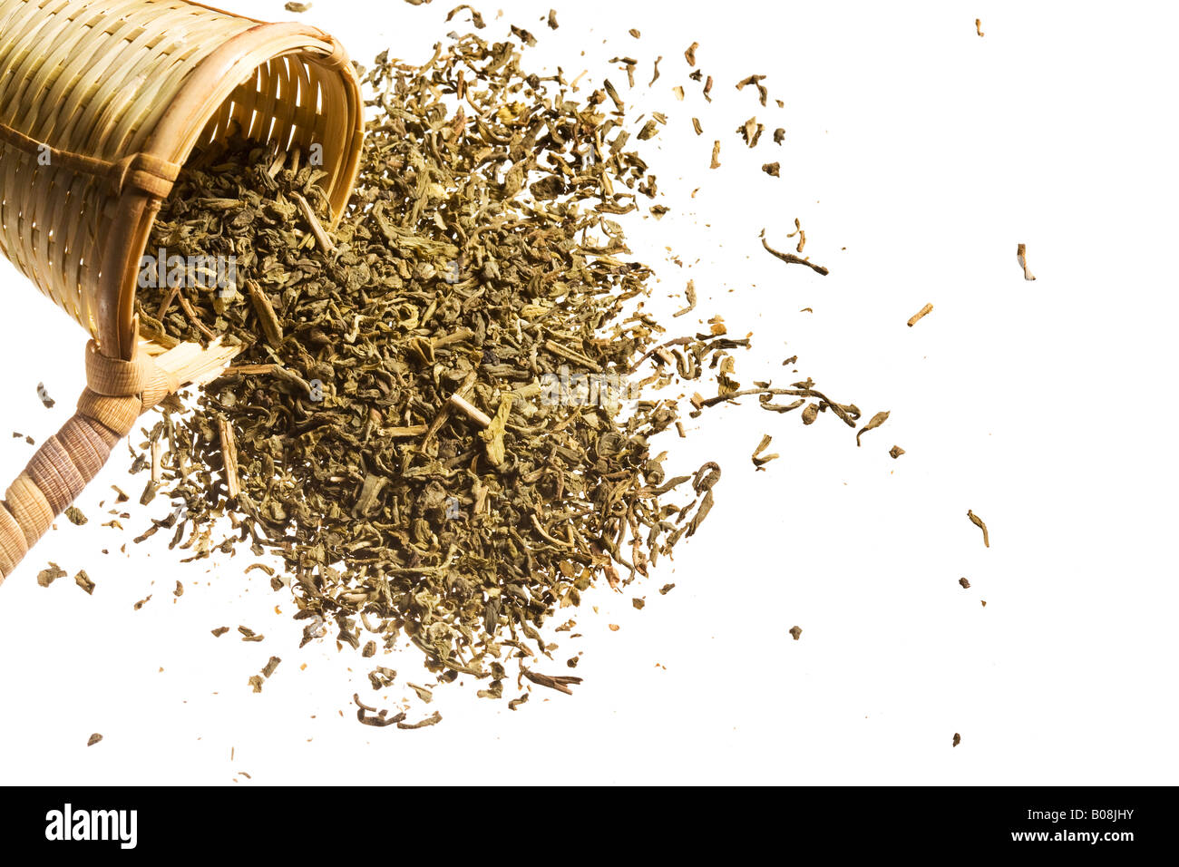 An overspilling scoop of raw tea. - Stock Image