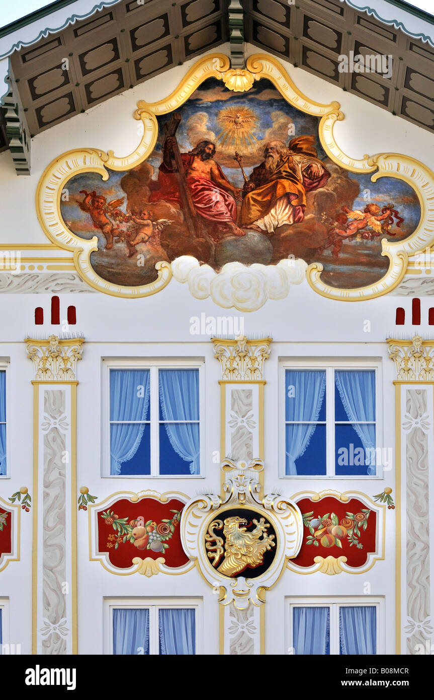 Building facade brightly painted with religious motifs (lueftlmalerei), Town Hall, Bad Toelz, Bavaria, Germany - Stock Image