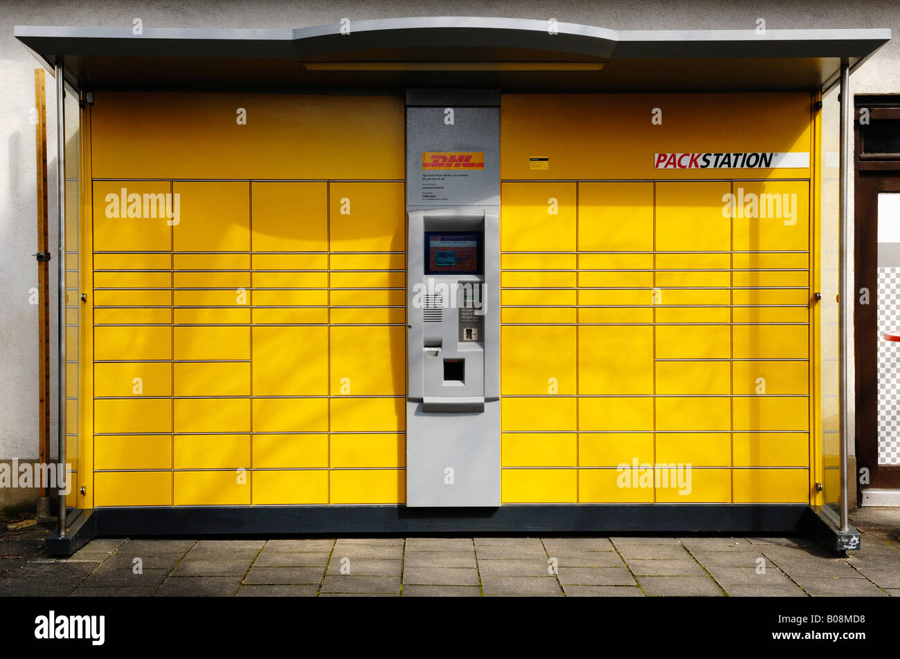 DHL automated parcel collection point, Munich, Bavaria, Germany - Stock Image