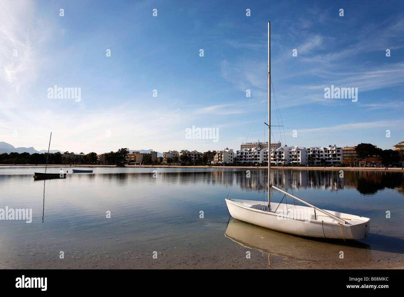 Boat anchored at Port Alcudia, Majorca, Balearic Islands, Spain - Stock Image