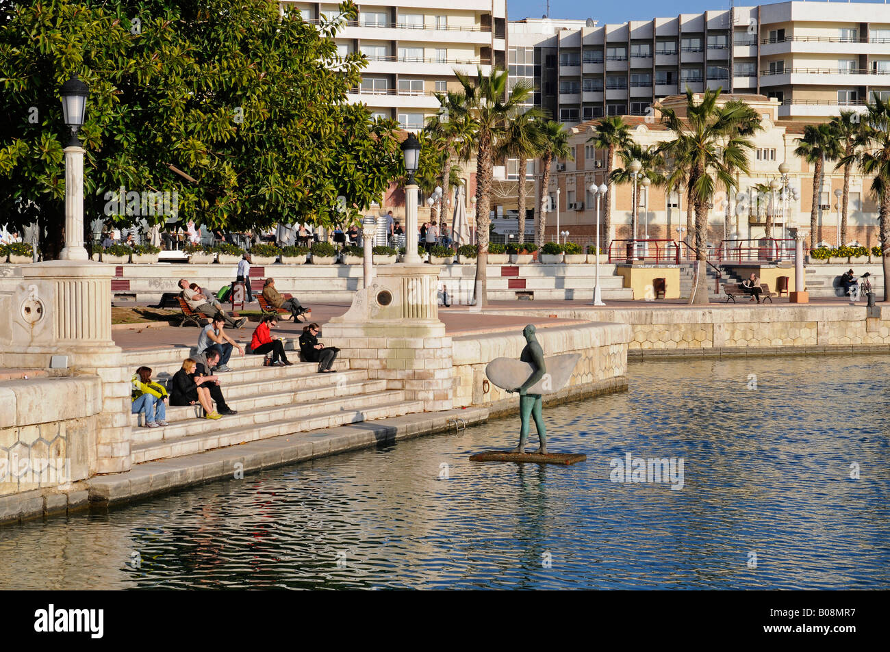 People and sculpture at the marina in Alicante, Costa Blanca, Spain, Europe Stock Photo
