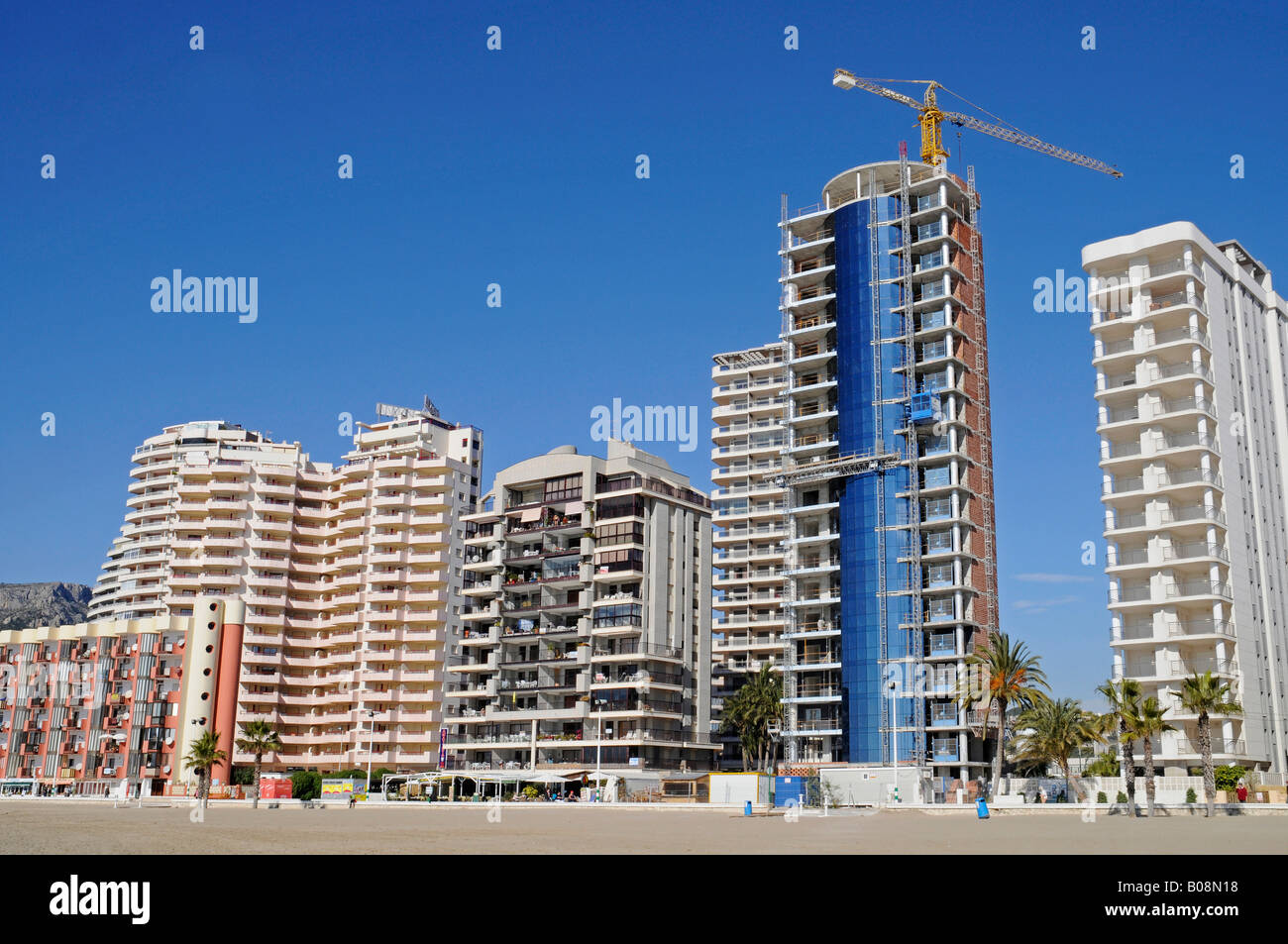 Multistory buildings, high-rises on the beach, Arenal, Calpe, Alicante, Costa Blanca, Spain - Stock Image