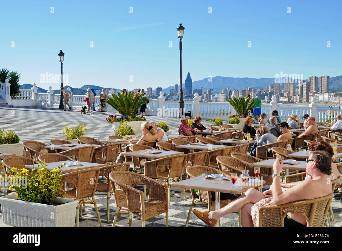 Tourists sitting at a street cafe, viewing platform, Balcony of the Mediterranean, Benidorm, Alicante, Costa Blanca, Stock Photo