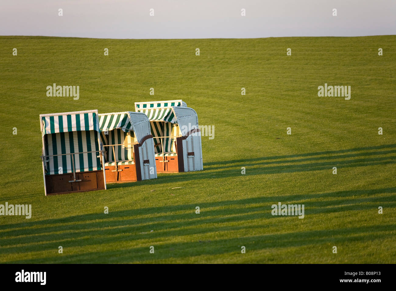 Empty beach chairs on grass, North Frisia, Schleswig Holstein, Northern Germany - Stock Image