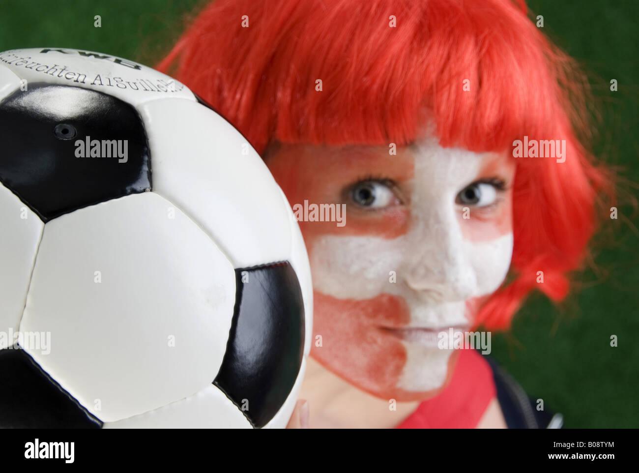 woman as Switzerland football fan, with football - Stock Image