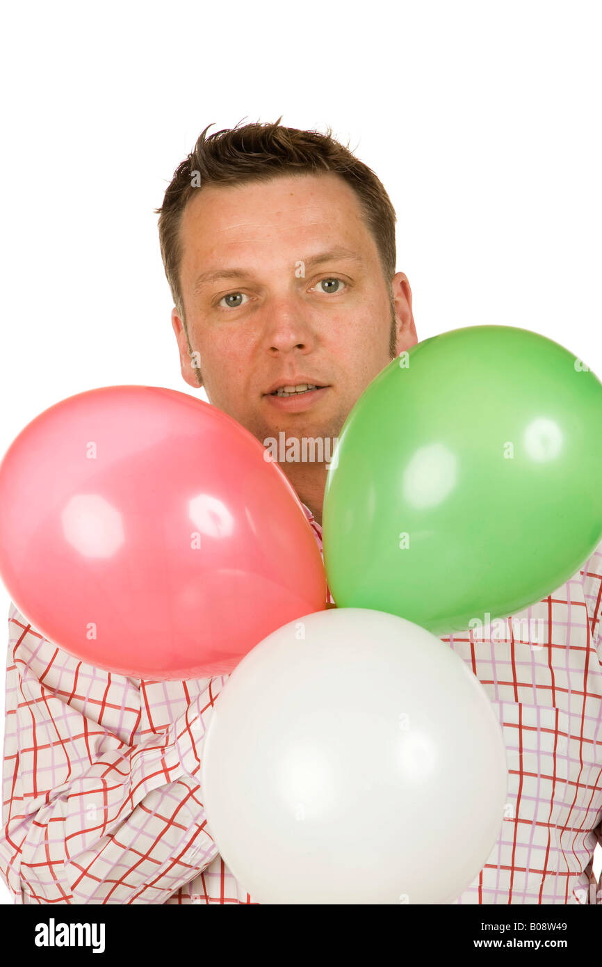 40-year-old man holding balloons - Stock Image