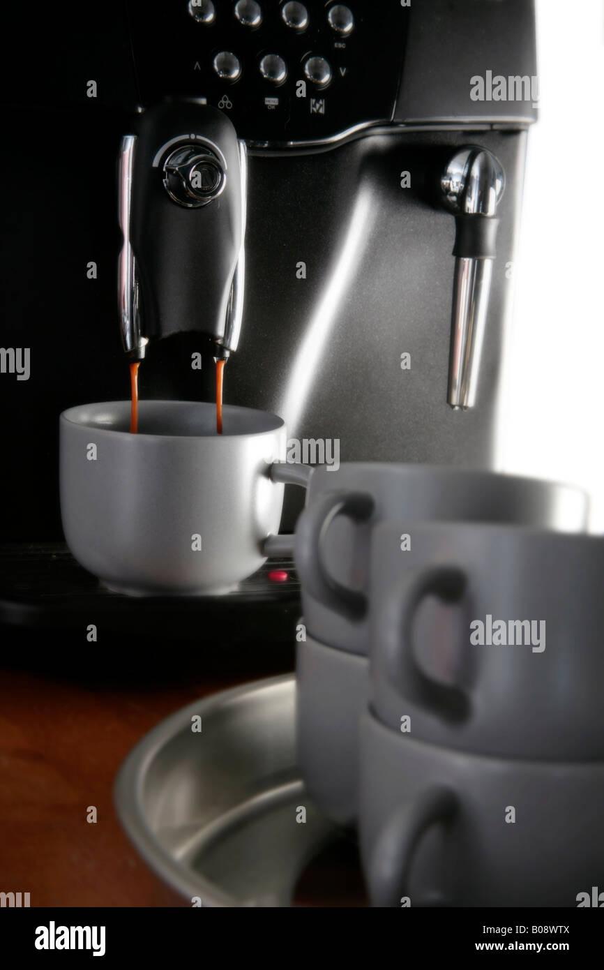 Espresso maker brewing fresh coffee - Stock Image