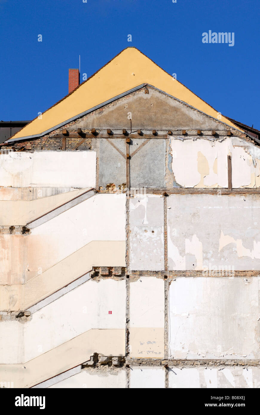 Exposed wall of a demolished terrace house - Stock Image