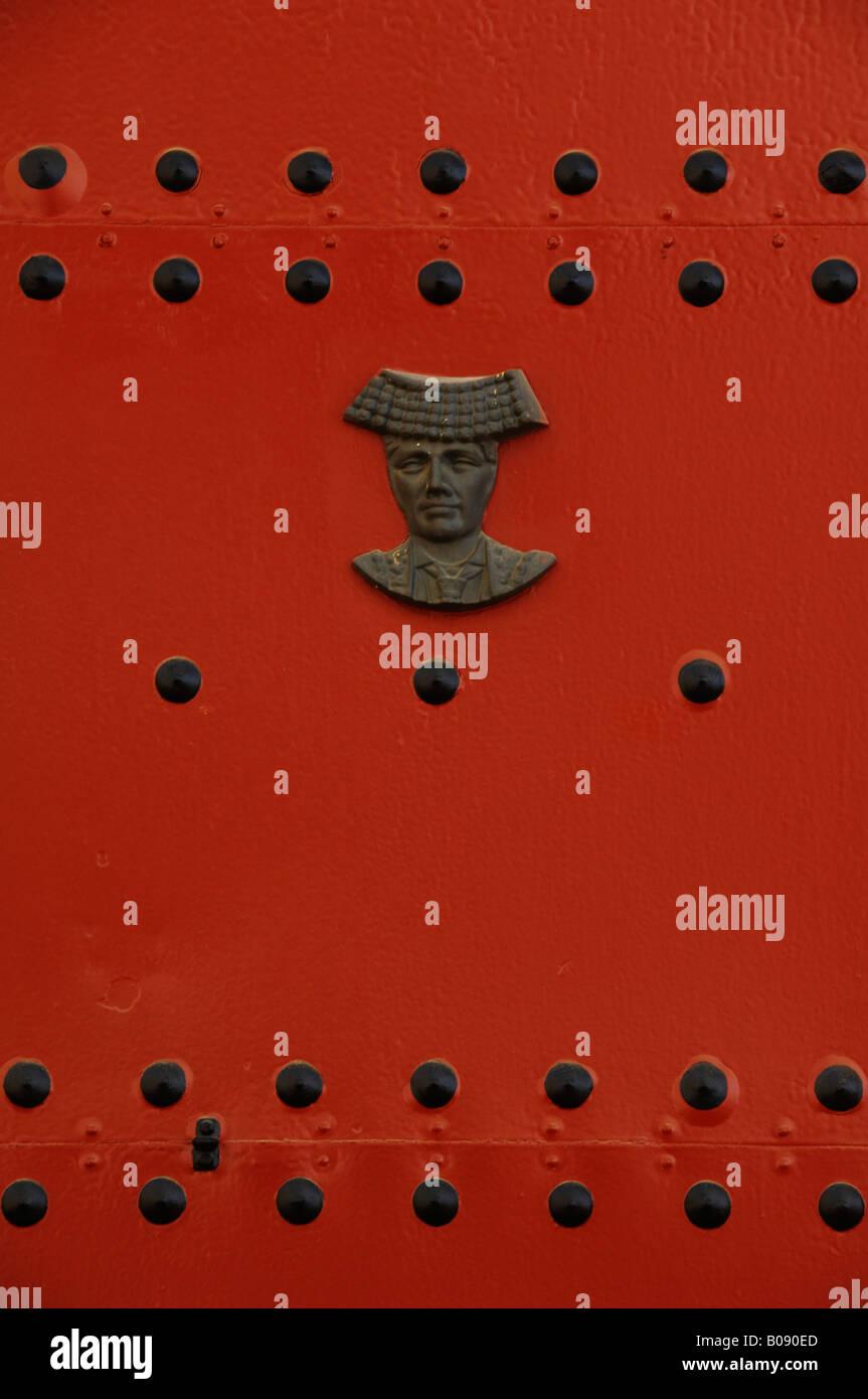 Head of a matador mounted on a red door, Real Maestranza de Sevilla bullring, Seville, Andalusia, Spain Stock Photo