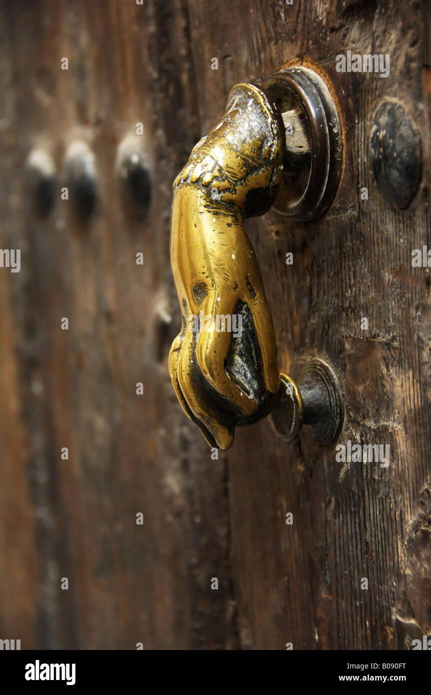 Doorknob, door handle on an old door in Seville, Andalusia, Spain - Stock Image