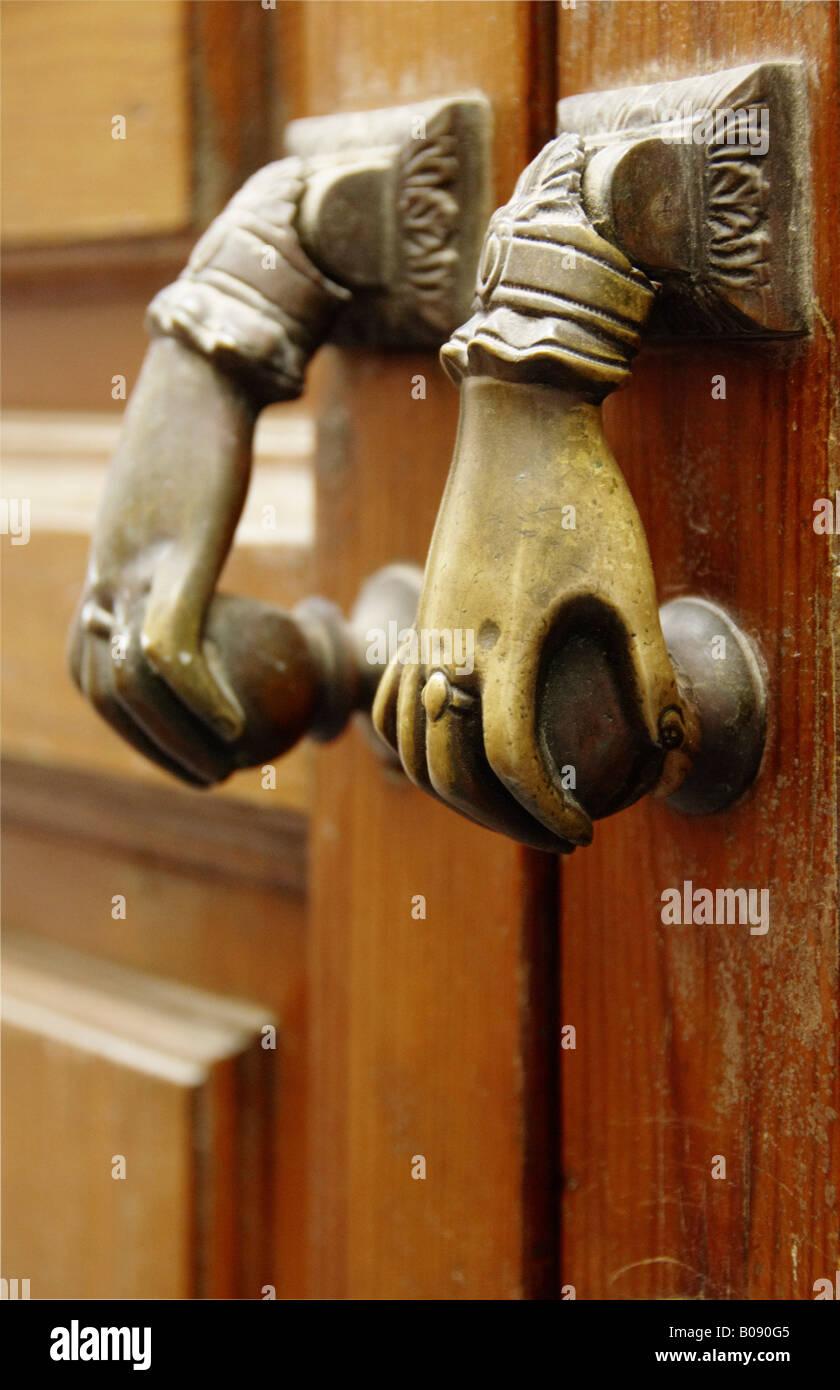 Two doorknobs, door handles on an old door, Seville, Andalusia, Spain - Stock Image