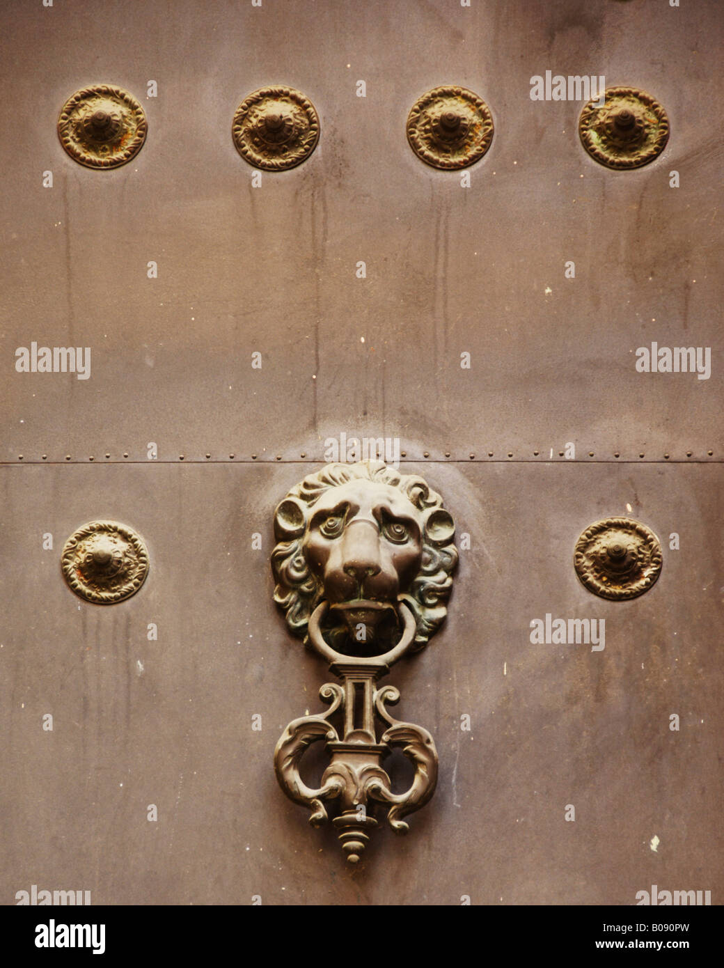 Lion head door knocker on an old door in Seville, Andalusia, Spain Stock Photo