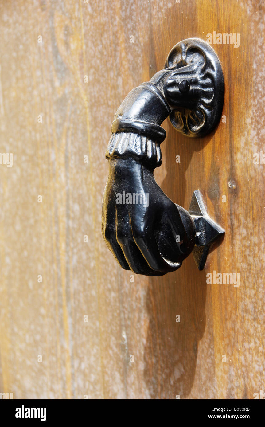 Ornate door handle on an old door in Seville, Andalusia, Spain - Stock Image