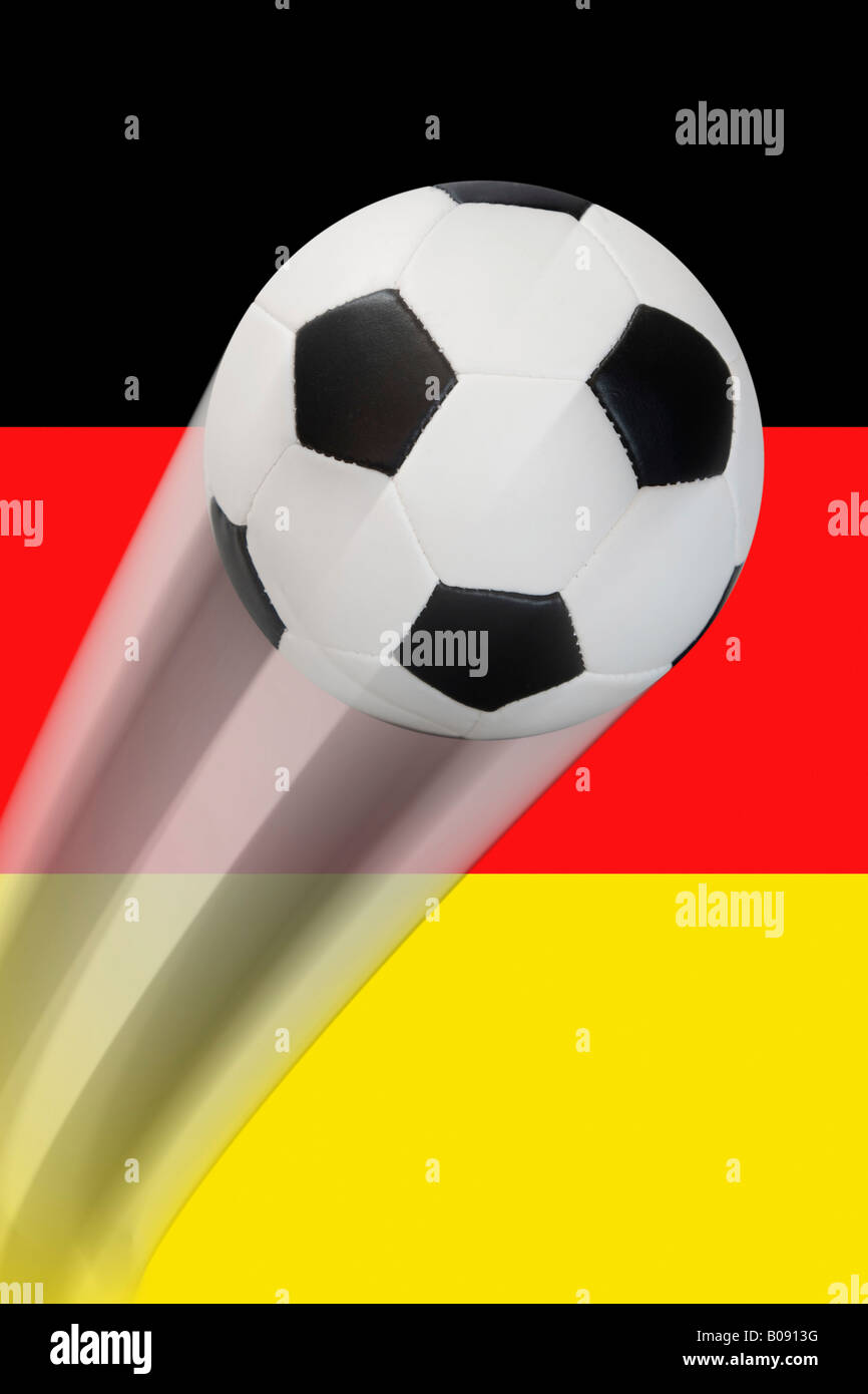 Football flying in front of a German flag - series Stock Photo