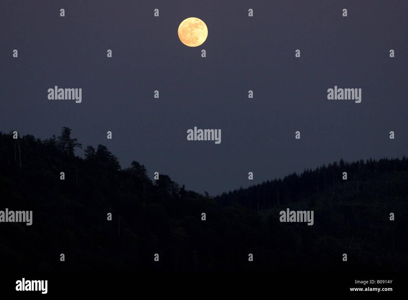 Moonrise over the Black Forest, Germany, Baden-Wuerttemberg, Baden-Baden - Stock Image
