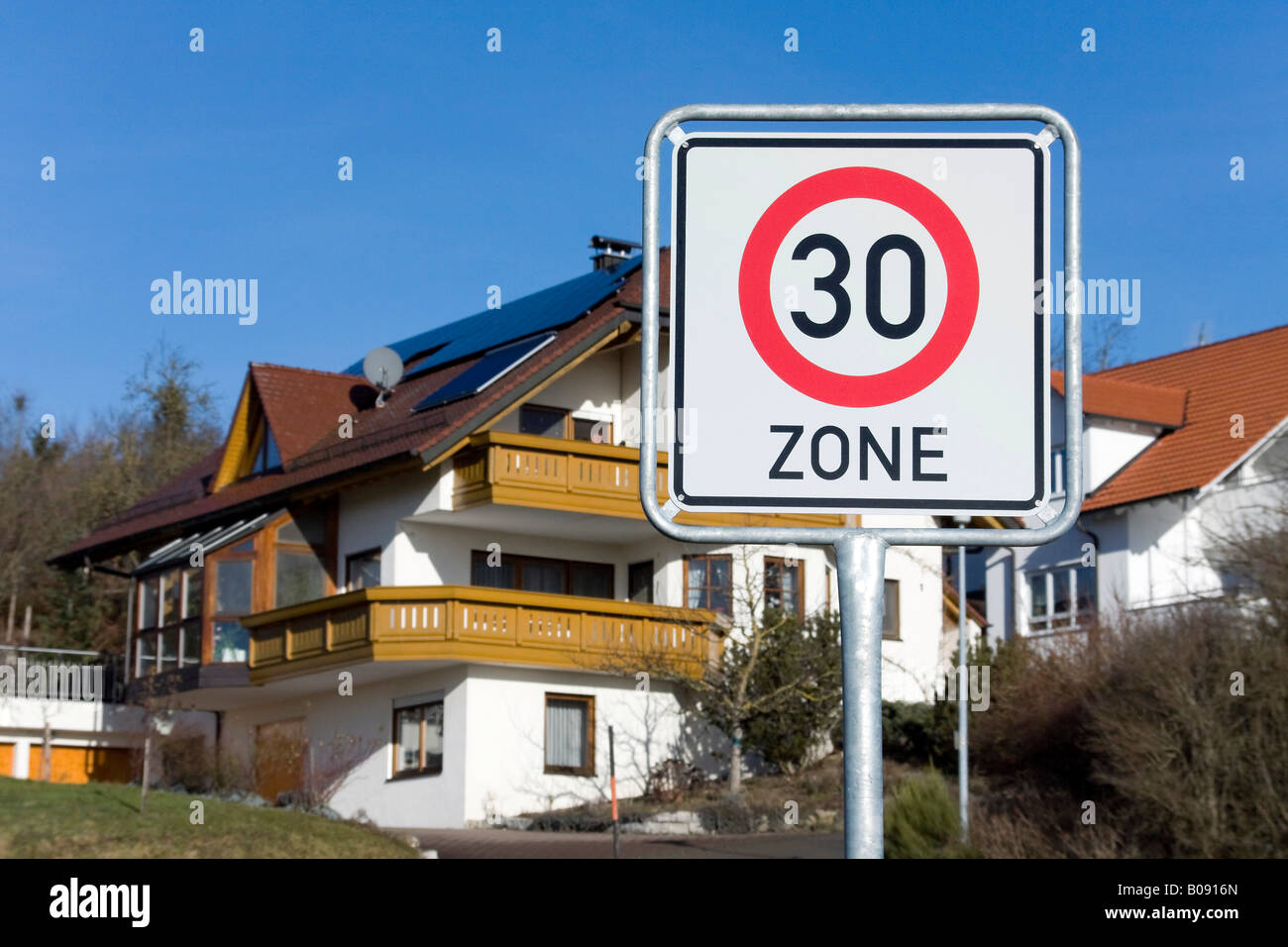 Traffic sign in a residential area, 30 km/h speed limit - Stock Image