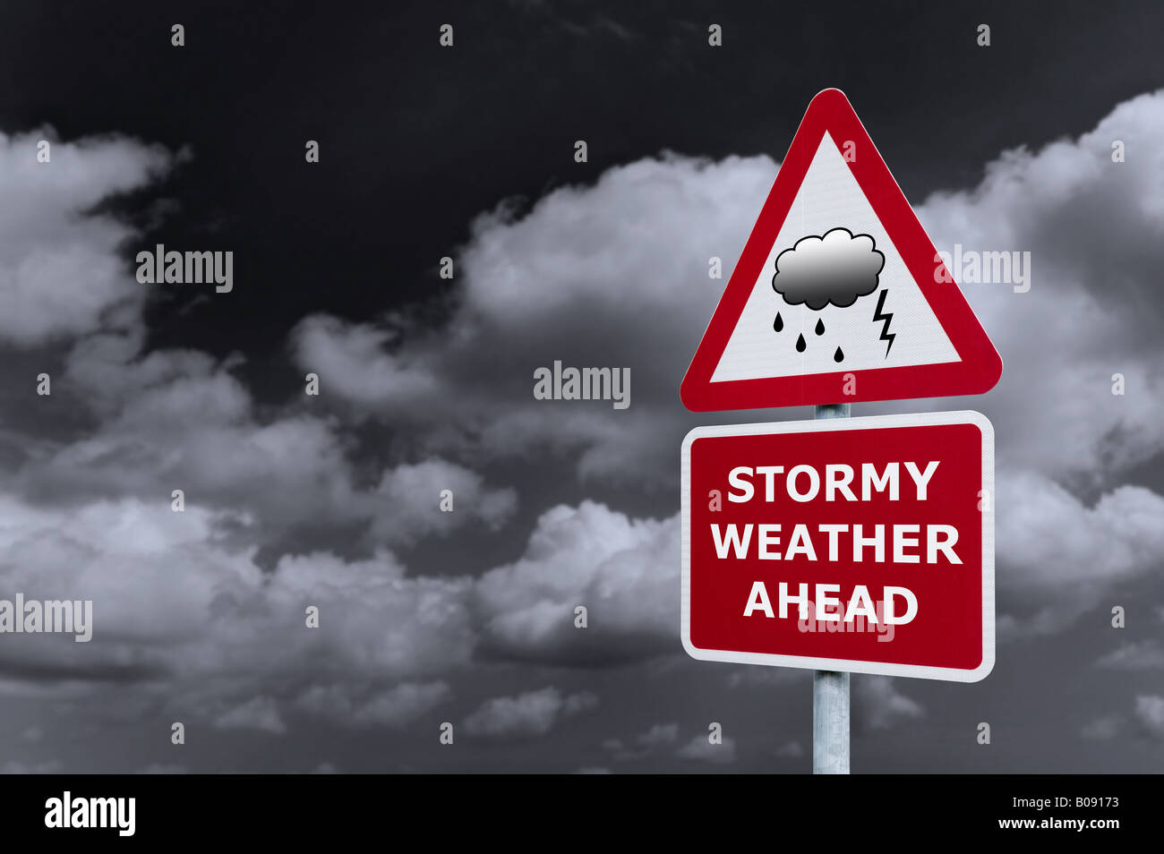 Concept image of a signpost with Stormy Weather Ahead against a dark cloudy sky - Stock Image