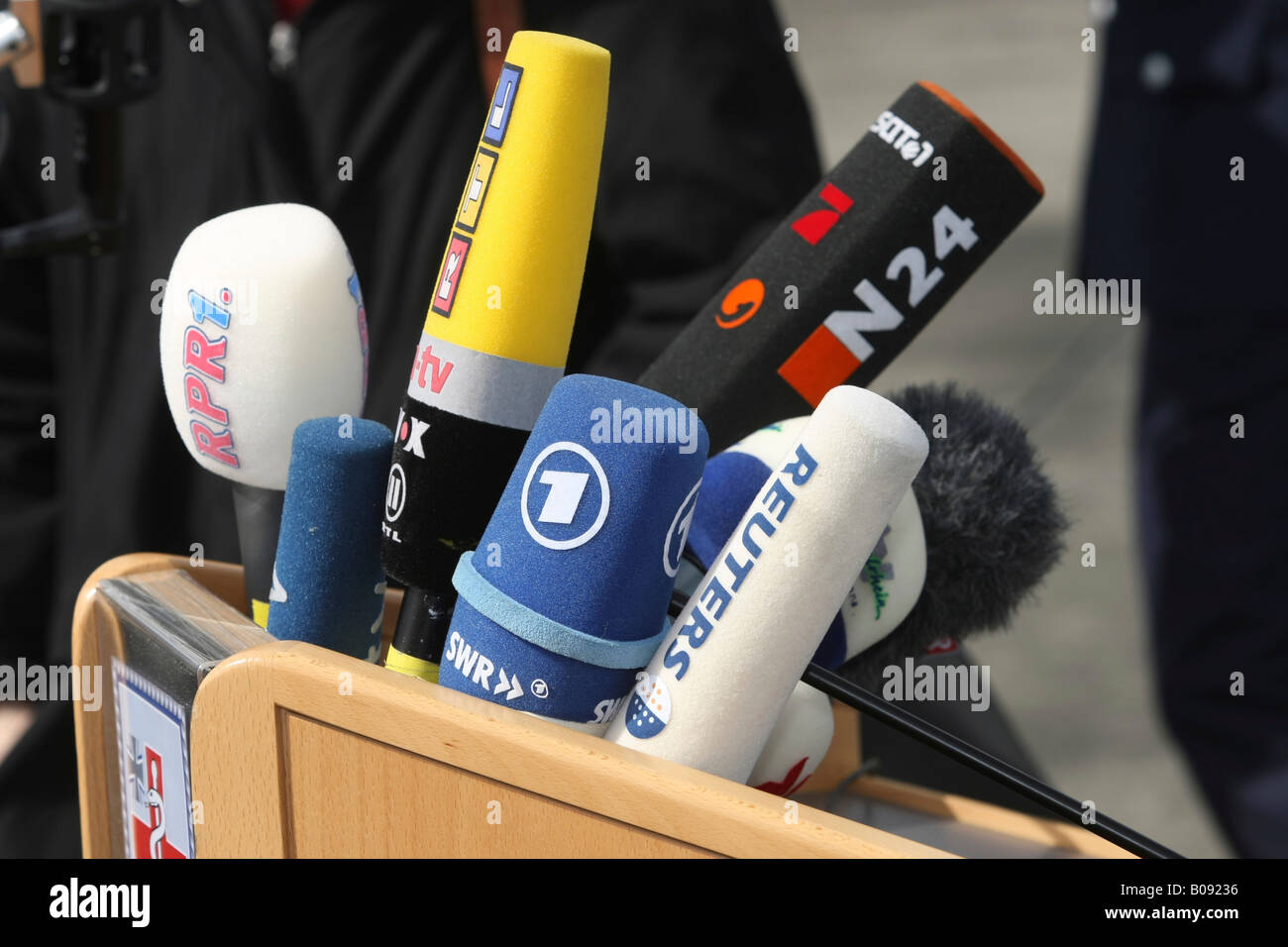 German press microphones attached to a lectern - Stock Image