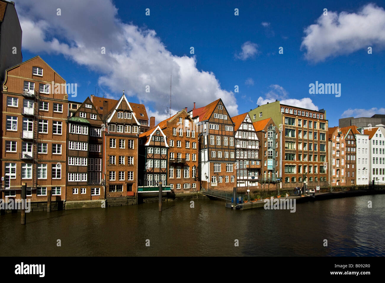 Historic warehouses along the Nikolaifleet waterfront in the historic centre of Hamburg, Germany - Stock Image